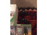 Xbox 360 with 2 wireless controllers and games in box