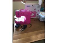 Silver mini pink sewing machine only used once as no idea lol