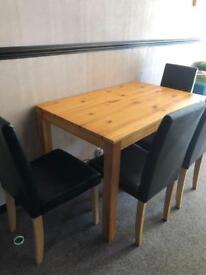 Table with chairs black faux leather
