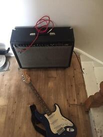 Blue fender squire bullet strat with fender ultimate chorus amp