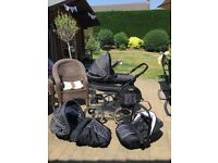 3 in 1 Pram Travel Combination . Handsomely Smart Black with White Polka dots. Carry bag included.