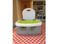 Portable high chair. Simple attachment to any dinning chair. Detachable tray.