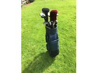 Set of Callaway, Ping and Mizuno clubs including bag and set of golf balls