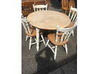 SOLID PINE CIRCULAR DROP LEAF TABLE AND 4 CHAIRS VGC