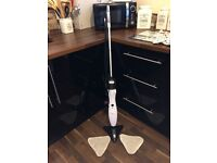 Floor steam cleaner with 2 washable cleaning pads.