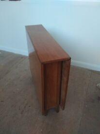 Designer vintage drop leaf dining table. Excellent condition. Can deliver free