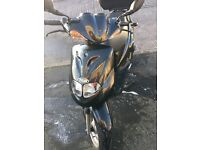 black 50 cc moped.