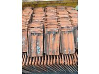 Belgian terracotta roof tiles. Free if you collect. Two sizes about 100 of each size.
