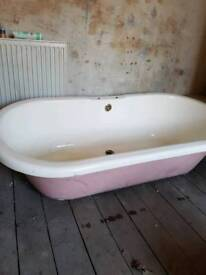 Victorian roll top bath with plaster legs