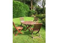 Hardwood garden dining table and 4 chairs
