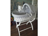 White and grey moses basket with stand