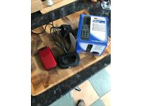 Mobile Phone Basic clamshell mobile phone boxed with charging cradle and all