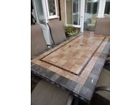 Garden table and chairs. Slate top. Suitable to be left outside in all weathers. Wipe clean