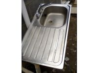 Stainless steel sink with new taps.