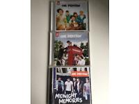 First 3 One Direction CDs