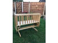 Rocking wooden baby crib