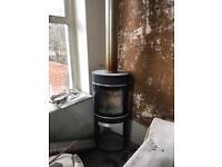 Free standing log burner.