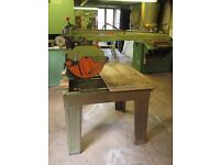 Dewalt Radial Arm Crosscut Saw with a stand, large capacity for cross cutting.