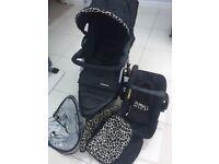 Mothercare xtreme black giraffe print pushchair travel system.