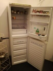 Candy fridge freezer. About 7' tall. Buyer collects.
