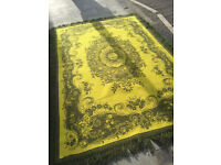 Large green rug with fringed edge, size 170cm x 250cm. In good condition.