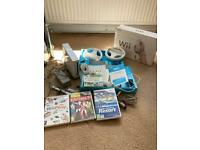 Wii console + 3 Games + Nunchuck + 2 Steering Wheels