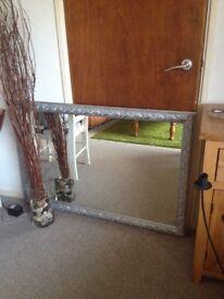 Silver and grey colour mirror