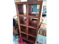 Large cube type book case made from Mango wood. Very sturdy and heavy.