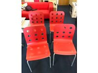 4 x red Ikea chairs