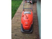 An easy glide flymo electric lawnmower.