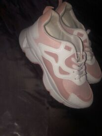 Pink and white womans trainers