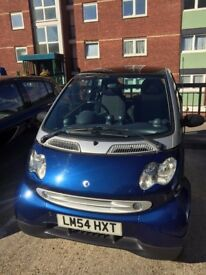 Blue smart car 2004 - perfect for the city and short drives
