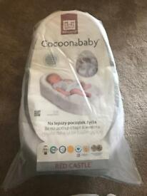 Cocoon a baby with extra fitted sheet