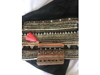 Embellished black clutch bag with matching purse
