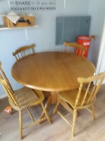 Solid wood kitchen table and chairs scratch on top but apart from that lovely solid set