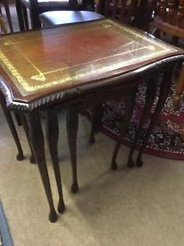 Set of three vintage nested tables leather and glass tops