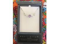 Beautiful silver plated 5 heart necklace with purple jewel. Brand new never worn.