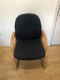 arm chair with wooden detail