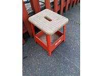 small metal framed stool with wood seat