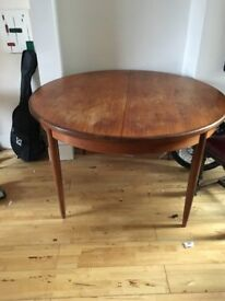 Beautiful Danish solid teak table with tapering legs