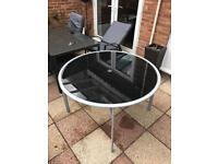 Glass round garden table