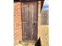 Thick solid wood shed door with hinges