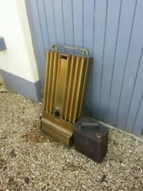 Alladdin oil burner radiator and also a vintage petrol can