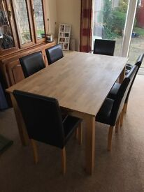Solid oak dining table with six chairs