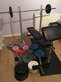 99kg of weights, bench, barbell and two dumbbells
