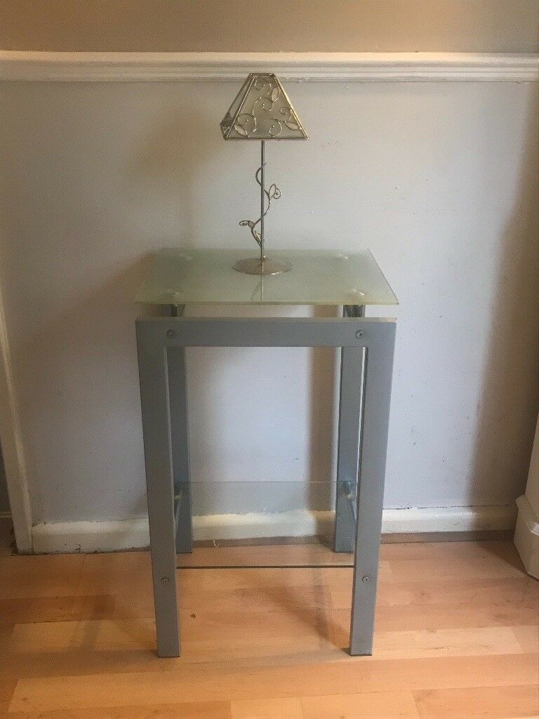 Silver side table with glass top