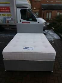 Grey fabric double bed with pocket sprung mattress and headboard