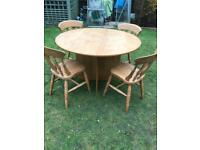 Pedestal base round table and four chairs ( can deliver )