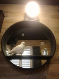 Round real wood mirror stained matt black with a shelf through the middle light included.