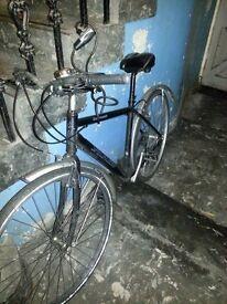 Hybrid bicycle, pump and Bell helmet